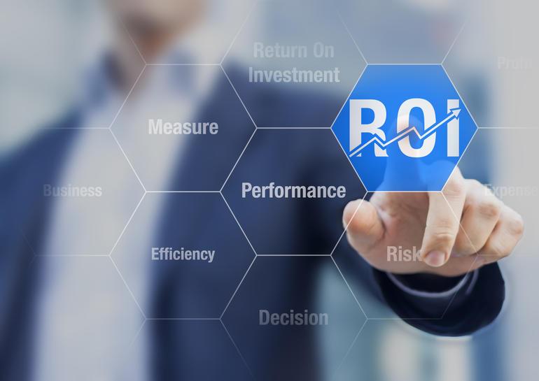 Businessman using ROI Return on Investment indicator for improving business performance