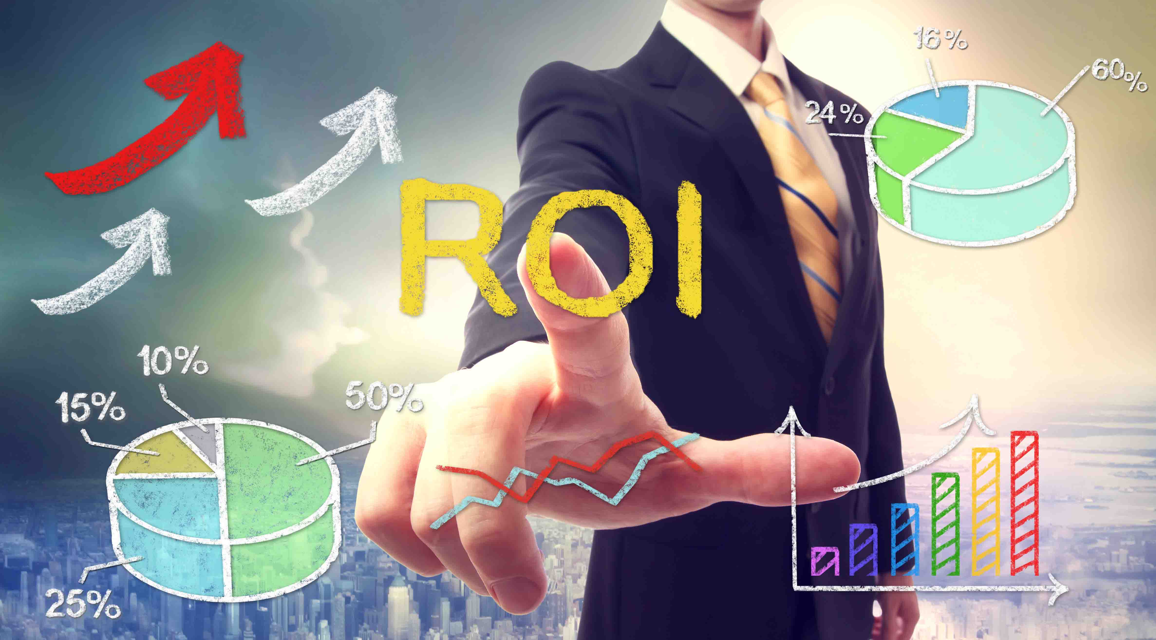 Businessman touching ROI (return on investment) over skyline background